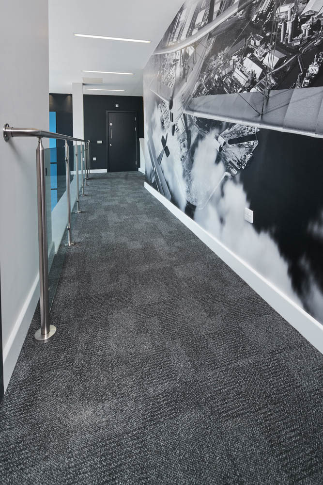 Cove base in hallway with mural.jpg