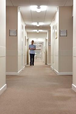 Healthcare - Nurse Walking Down Hallway.jpg