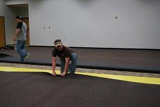 Carpet is being ajusted to proper position over the Lok-Lift.