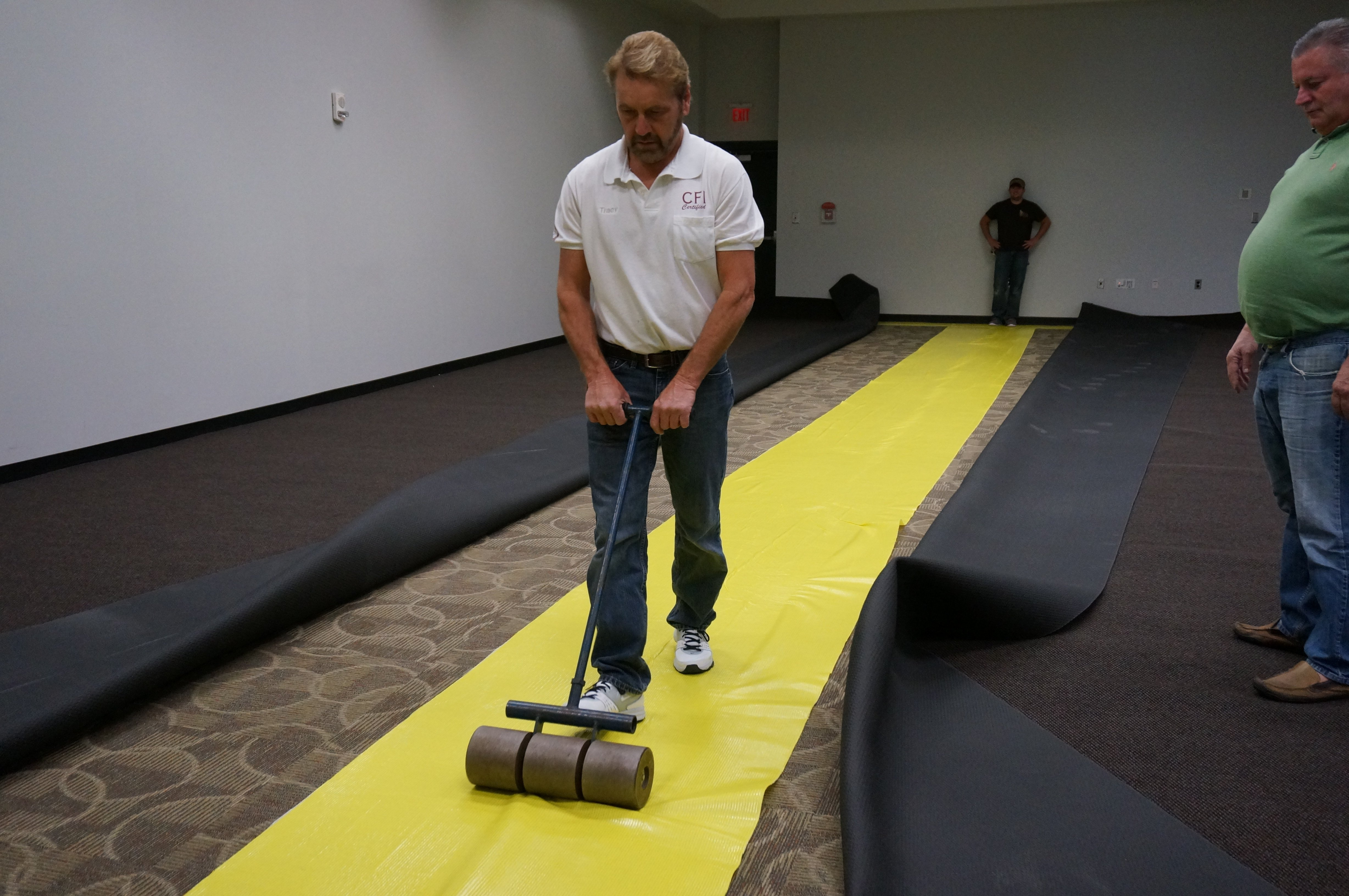 Lok-Lift should be pressed down with a roller to help secure the pressure sensitive scrim to the floor.